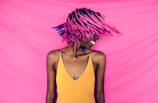 girl-shaking-her-pink-braided-hair-PQ2XN6P